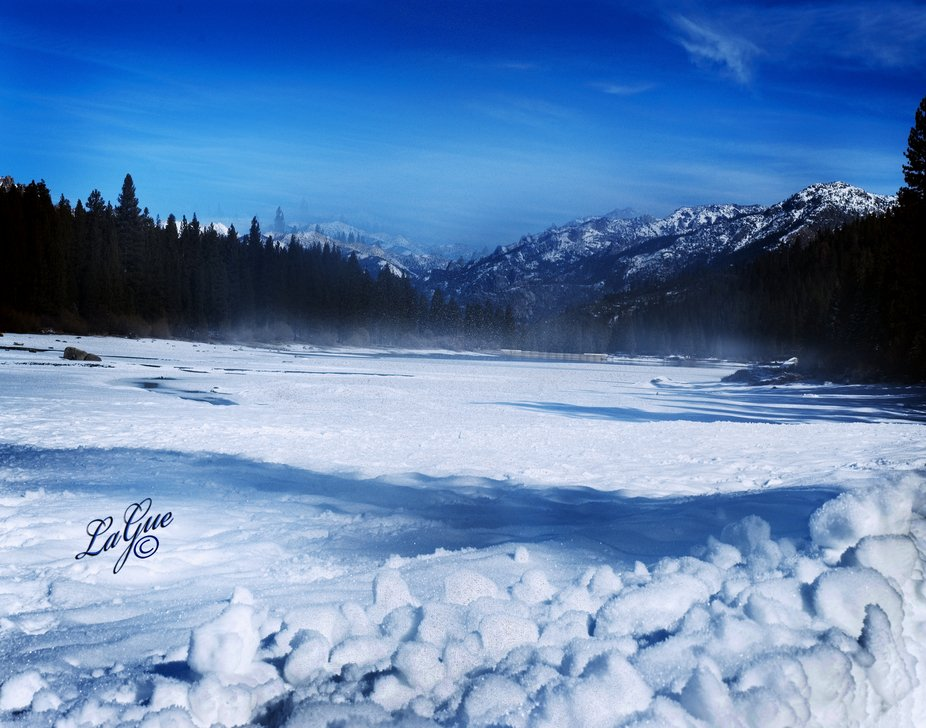Peaceful snow and frost covering the hidden lake sleeping quietly captive until spring.