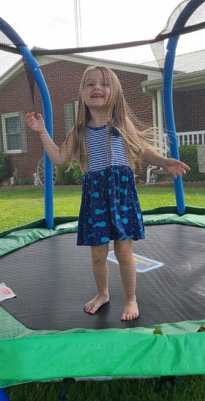 Granddaughter playing on trampoline