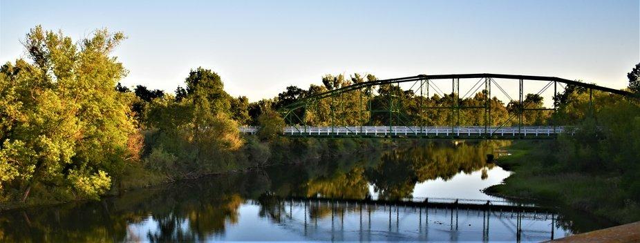 A pretty shot of a bridge over the river on the way to Modesto CA.