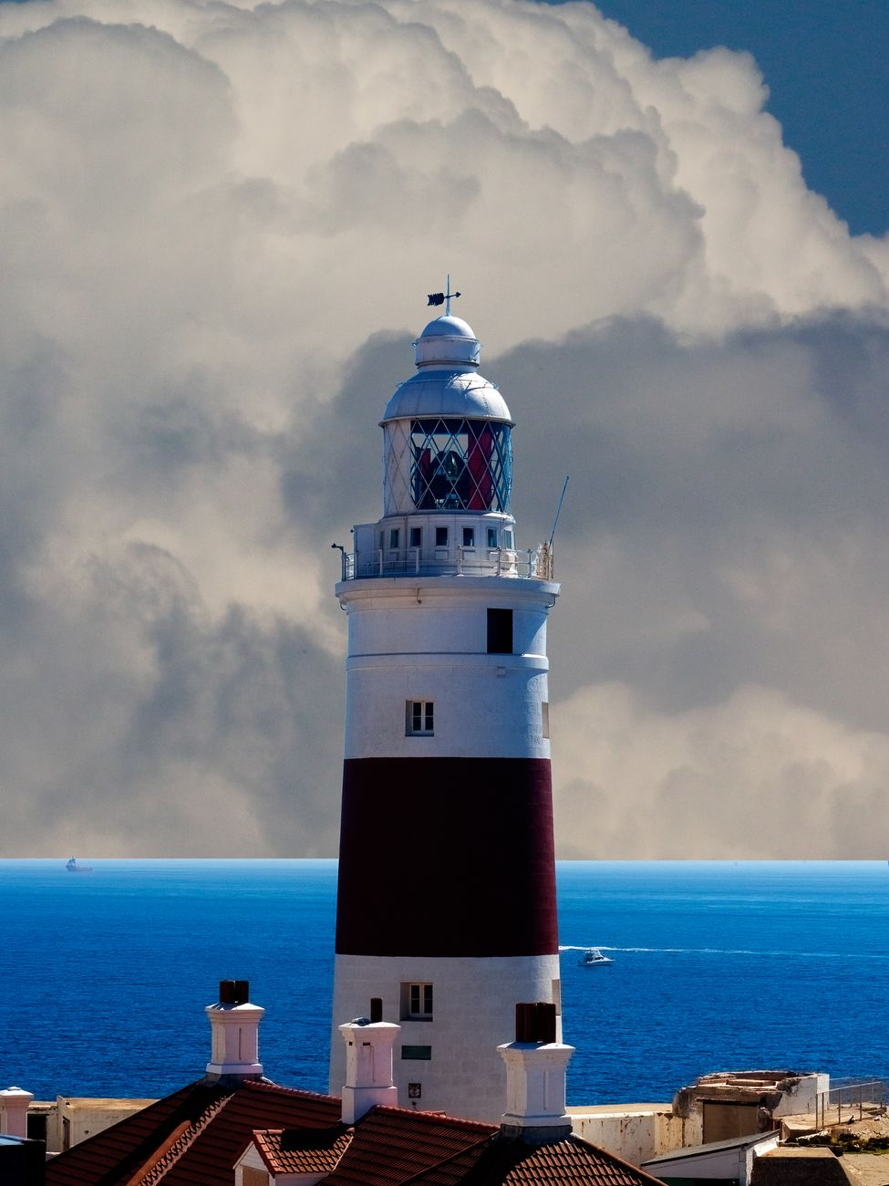 Morning view of the lighthouse in Gibraltar, with the Mediterranean Sea in the background.