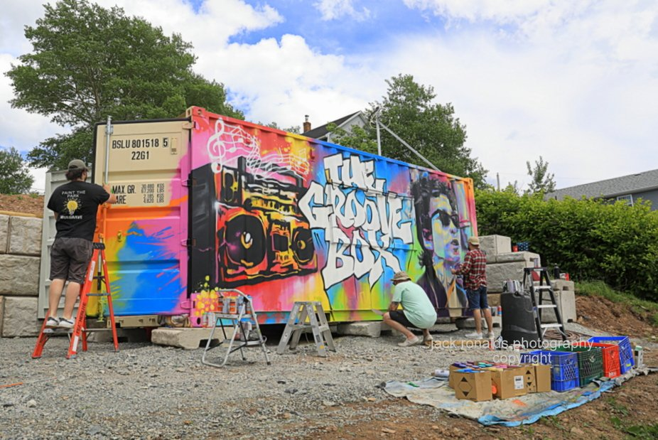 3 guys from Halifax N.S. creating a mural on a new business soon opening up in my hometown of Por...