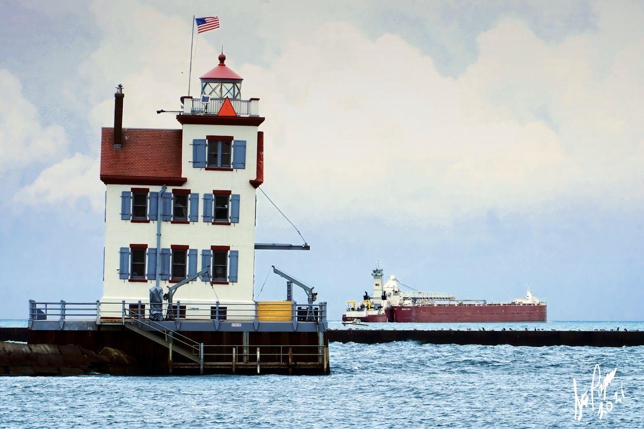 DIRK S.VANENKEVORT pushing the Michigan Trader out of Lorain. Taken 06-19-2021