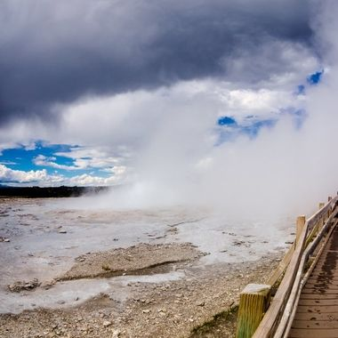 Among the many sparsed out geysers in western Yellowstone, some of which spout out enormous amounts of steam and then erupt. Of which you can walk through the steam tails of a few of them. This was one of them, multiple people attempted to walk through the steam tail only to turn back because of the heat.