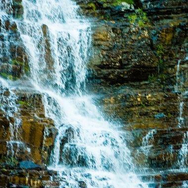 Never-ending waterfalls in glacier national park.