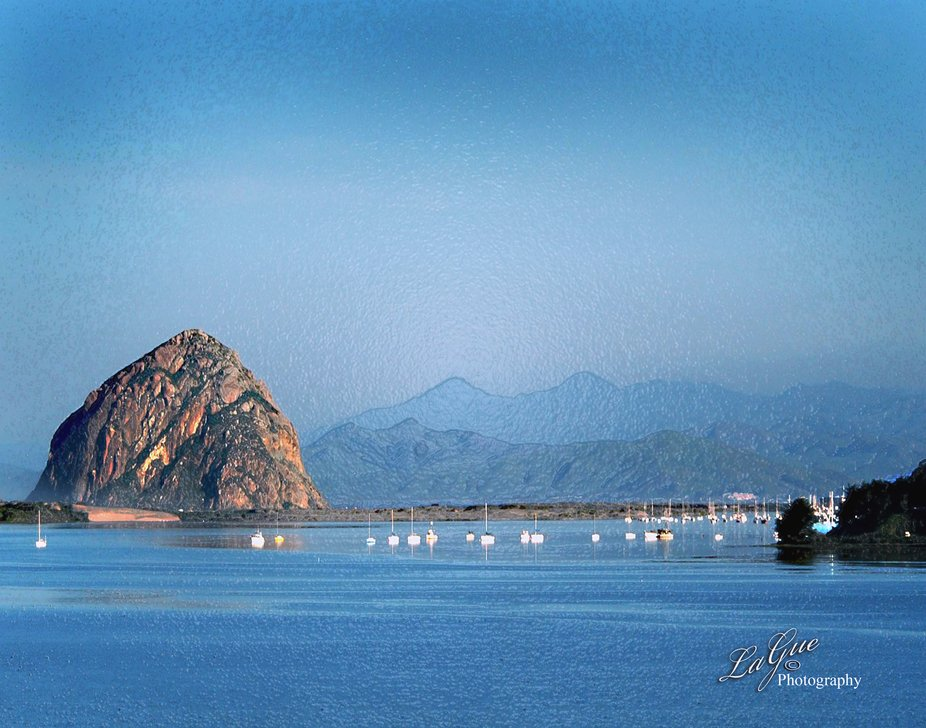 Early morning walk looking out at the peaceful view of majestic Morro Rock in the bay with all the sleepy sailboats tied up and waiting for their adventures to start.