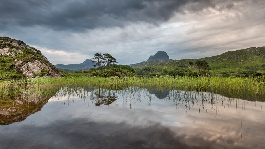 A sunrise image taken from the edge of a lochan on the way to summiting Suilven.