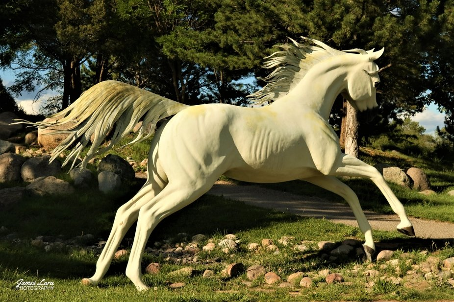 This small oasis, located near the Ruidoso Downs Race Track hosts 7 bronze sculptures of horse br...