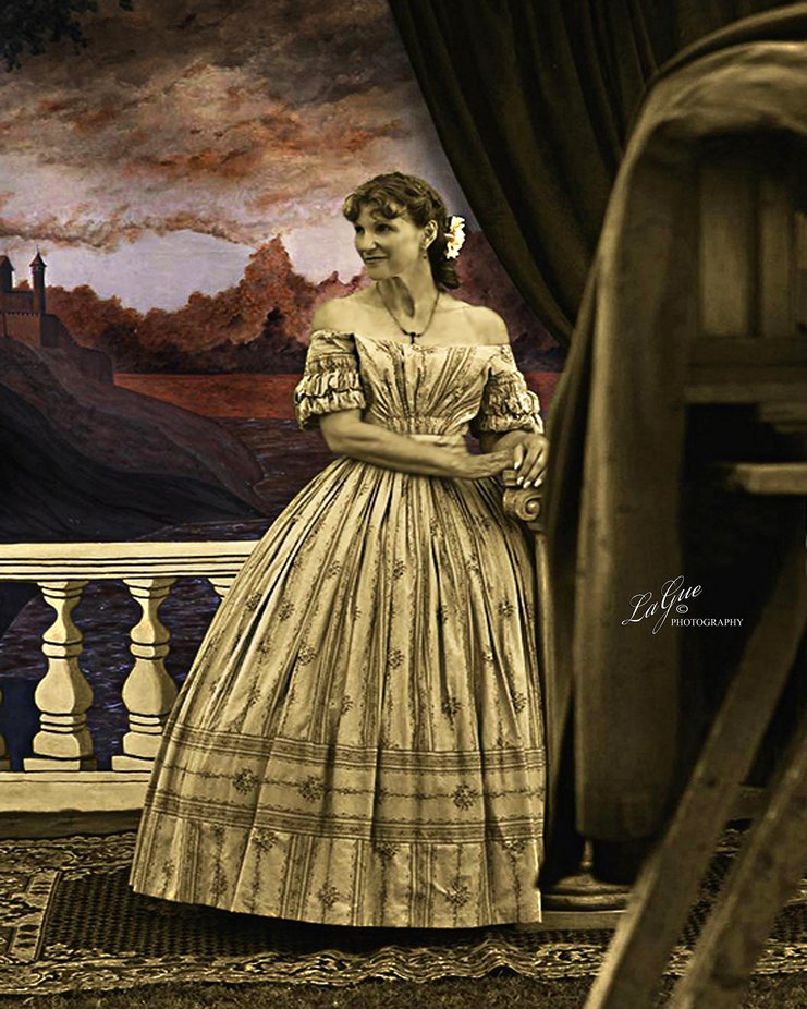 This image was taken at a Civil War re-enactment with a Lady in period clothing on a stage with a really old vintage wooden camera, and a hand-painted backdrop.