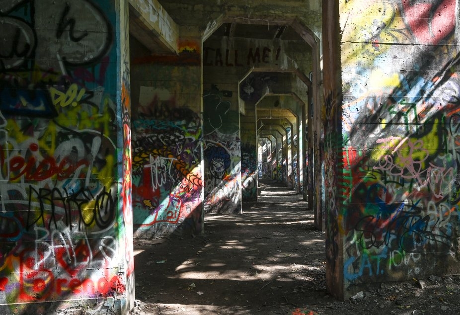 An abandoned pier for decades has provided a canvas for untold numbers of graffiti artists in Phi...