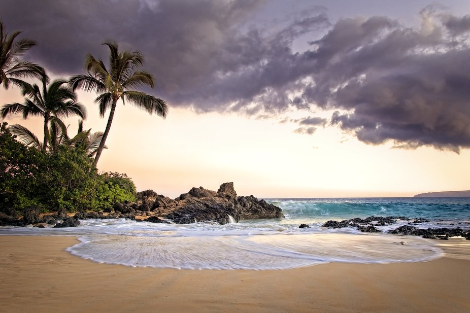 """A beautiful small cove on the coast of Maui is referred to as the """"Secret Beach"""" but there are many people here at all times and is used for weddings and special gatherings for the island."""