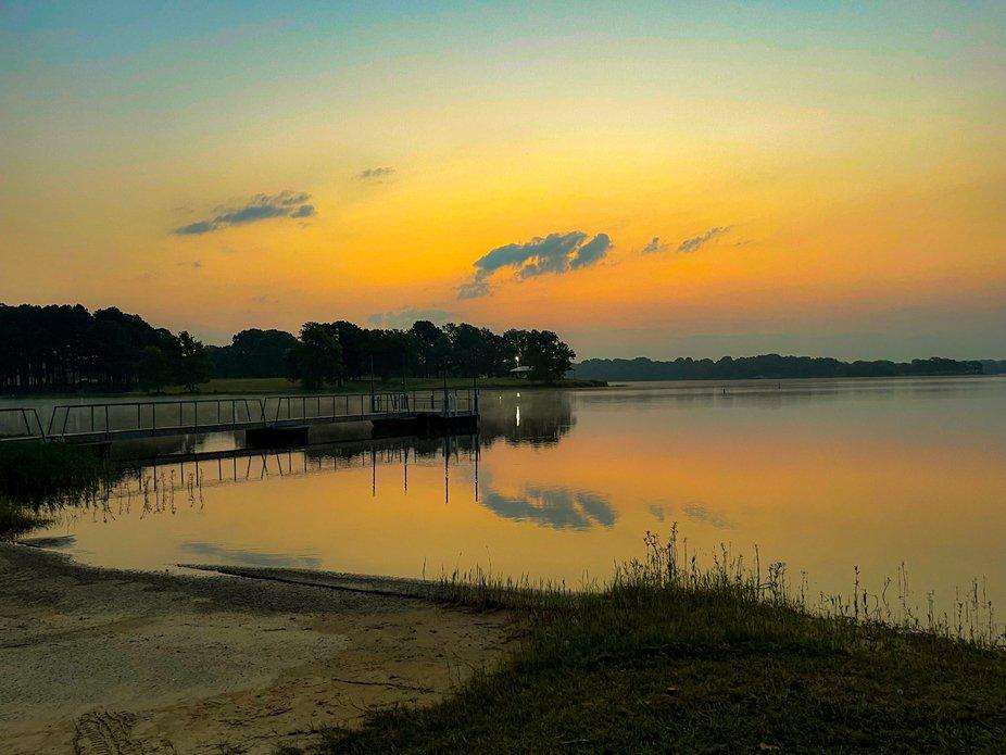 Reflections of sunrise on Holdenville Lake in Oklahoma Summer 2021