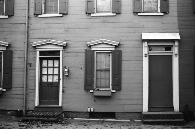 A symmetrical house design that has been remodeled from sometime around 1800s.