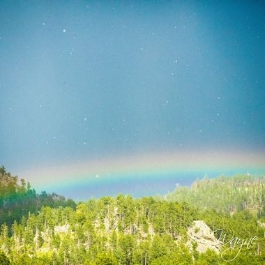 As soon as we pulled into the parking lot at Crazyhorse in South Dakota we had rain as well as pea-sized hail and a rainbow. If you look really closely you can see the falling hail.