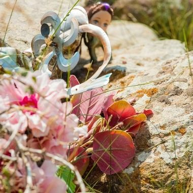 Within Custer State Park in South Dakota, there's a childs gravesite which has flowers and other things which were left. When I originally snapped this photo the doll at the top peeking out from underneath all the other things left was not seen. My girlfriend and I both missed this completely and it sort of creeped us out.