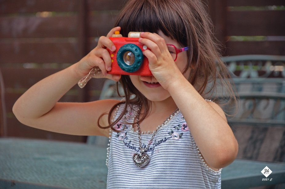My grand daughter, Mélodie is doing like her grand father with the passion of photography and sh...