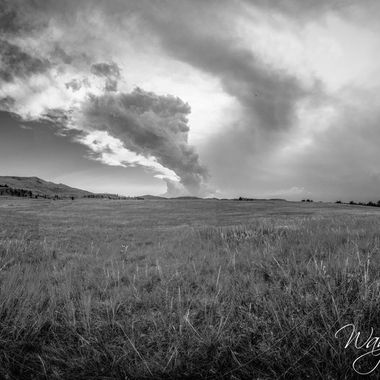 Just east of Newcastle Wyoming we hit a huge thunder and lightning storm. Pea to quarter sized hail and we just made it in time as the heavens let loose.  This is a panorama stitched together of 12 different fish eye photographs in lightroom then B&W converted.  From our Montana to South Dakota and back 2021 Vacation.  Color version is in my photos as well.