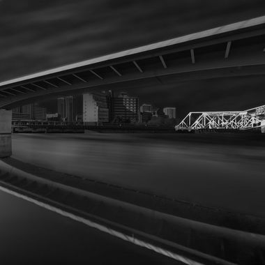 Concrete ramp spanning Charles river with steel truss RR bridge