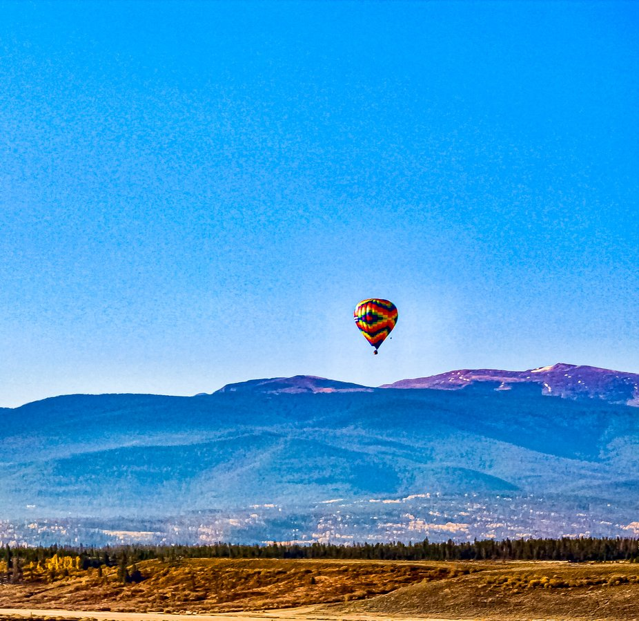 Hot Air Balloons over the Rocky Mountains.