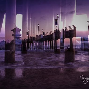 Huntington Beach Pier double exposure one from the side and one from underneath just inside the waterline. We took a beach day to go down and do some relaxing, ended up being a very uneventful day and very relaxing.   Had the opportunity to take quite a few shots while we were at the beach for the day. Had a great time and did a whole lot of basically nothing while we were there.  There's something so soothing about sitting with your feet and butt in the sand all afternoon and just people watching.