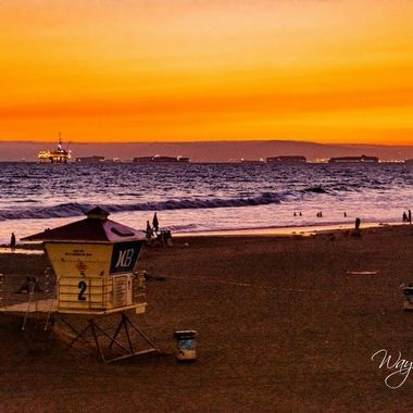 Decided to walk on the pier with my girlfriend and found some really interesting shots to take of the next-door lifeguard tower just around sunset.    There were quite a few big container ships anchored out most likely awaiting porting at Long Beach as well as some other ships which were out and about. Made for some interesting backgrounding and once the sun started to go down the lights twinkling were mesmerizing.
