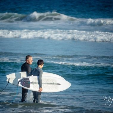 There's a surf school right where we parked, looked like a dad and his son out taking lessons and learning how to surf. Kept an eye on these two as well as a pair of others to see how they were doing.