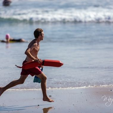 Lifeguards are always present during daylight hours. This one ran out into the surf after someone while we were sitting there.