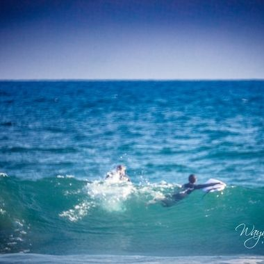 There is a surfing school in the parking lot where we were located, this son and dad were out learning to surf.