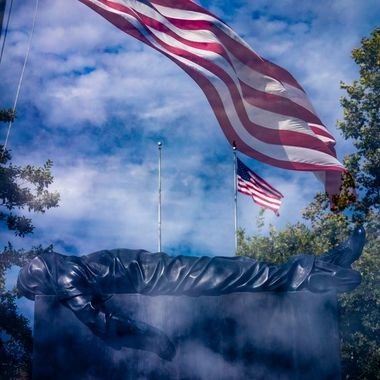 Flag at Riverside National Cemetary in Riverside, CA superimposed (double exposure) over the top of the Veterans statue near the entrance.  My grandfather and a few other people I know are burried/interred at this particular cemtary. My dad as well as my uncle's funeral services have been held here. This is a very special place for me as it holds memories, just not the greatest of memories.