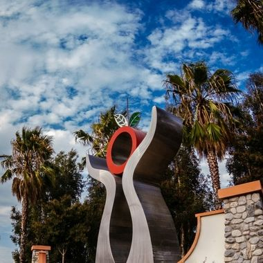 Down the street from my home is a sculpture symbolizing an orange and a pair of hands holding it up. Our area is known for citrus fruits, especially oranges.
