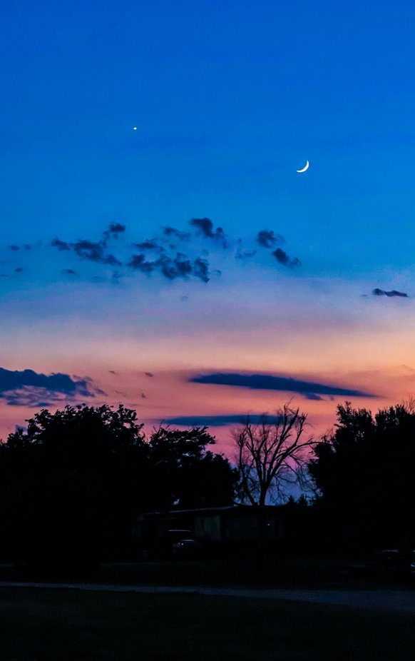 A summer evening in the Texas panhandle with the North Star and crescent moon.