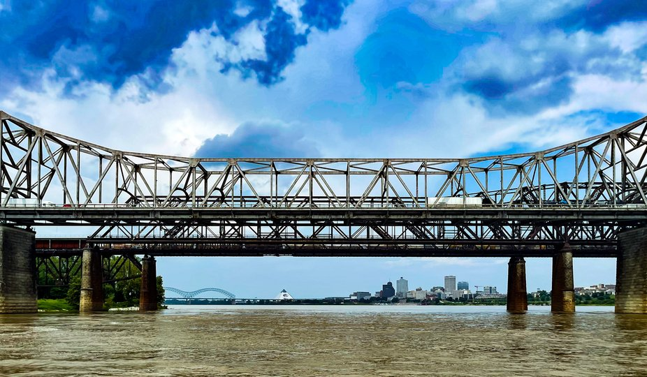 The Mississippi River with the Bass Pro Shop and downtown Memphis and the I40 bridge in the background.