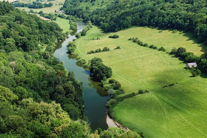 Symonds Yat is a village in the Wye Valley and a popular tourist destination, straddling the River Wye in the English county of Herefordshire, close to the Gloucestershire border. It is within a few miles of Monmouthshire and the Welsh border.