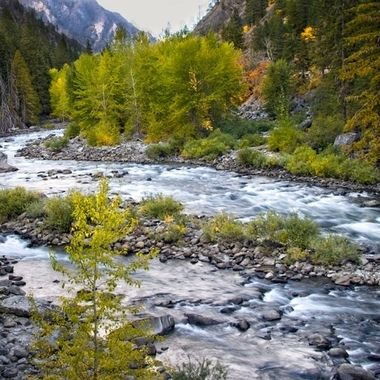 The rivers flow through the canyons of the Cascade Mountains near Leavenworth, Washington. The Fall Colors are beginning to show.