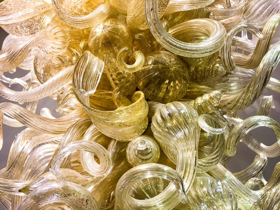 Clear Cream and Gold Glass. This is a close up of a chandelier that hung in the Mingei Internatio...