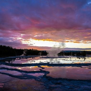 The water from this fountain geyser reflects the pastels in the sky.